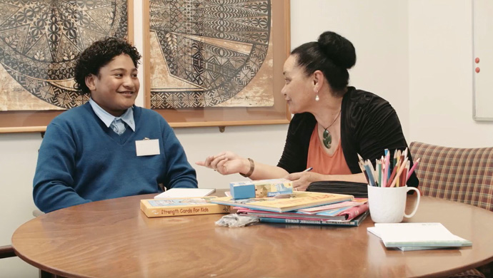 child male talking to a a Family Works Social worker